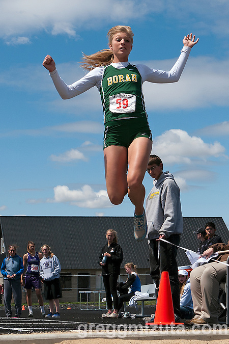 "Borah senior Brittany Owens soars to a meet record 20-00.25"" long jump during the YMCA Track and Field Invite on April 28, 2012 at Rocky Mountain High School, Meridian, Idaho. The mark is the third longest high school jump in the nation for 2012 and easily exceeds her state meet record of 19-01.00 set in 2010. (Gregg Mizuta)"