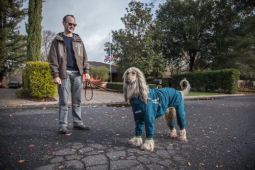 "Eric with his Afghan, Duke. ""I ordered this raincoat from Norway...they are very popular there."" eric@essvm.com (© Clark James Mishler)"