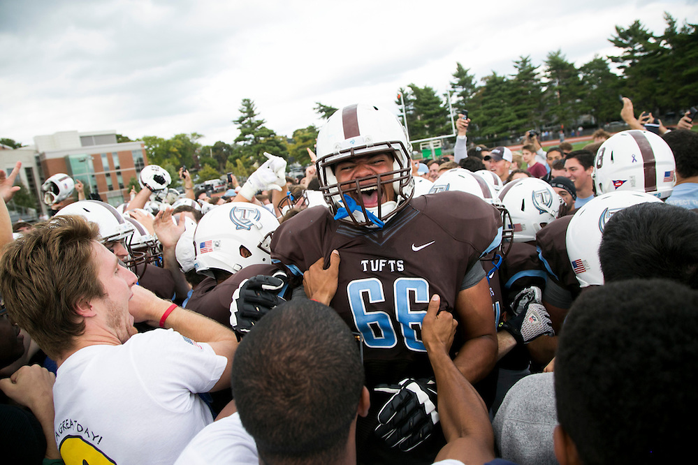 09/20/2014 - Somerville, Mass. - Tufts OL Justin Roberts, A16, celebrates on the field as fans storm the field after Tufts' 24-17 win over Hamilton at Zimman Field on Sept. 20, 2014. The win snapped a 31-game losing streak. (Kelvin Ma/Tufts University) (Kelvin Ma/Tufts University)
