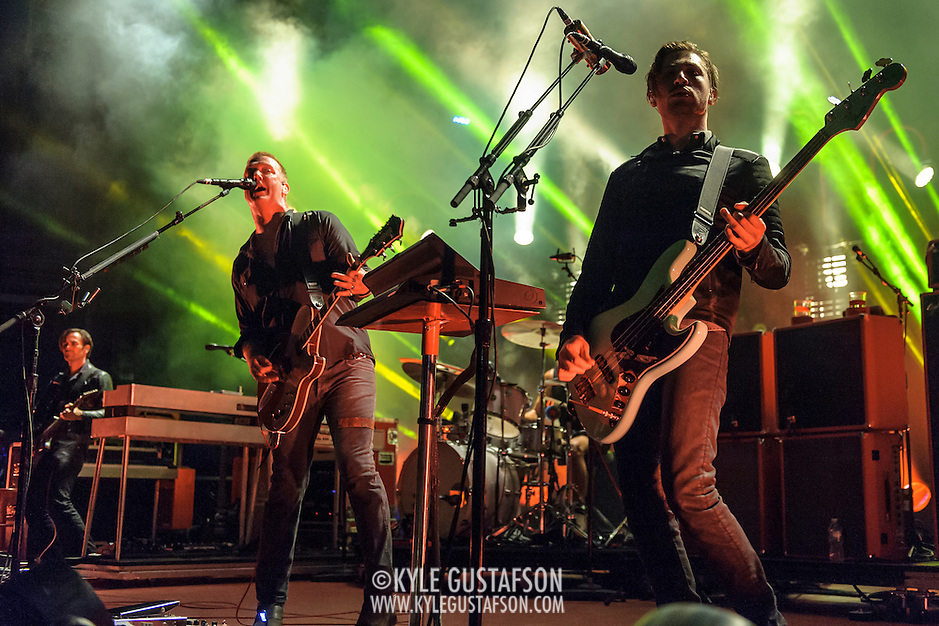 "COLUMBIA, MD - July 17th, 2014 - Dean Fertita, Josh Homme and Michael Shuman of Queens of the Stone Age perform at Merriweather Post Pavilion. The band's 2013 album, ""…Like Clockwork,"" was the group's first album to top the US Billboard 200 album charts. (Photo by Kyle Gustafson / For The Washington Post) (Kyle Gustafson/For The Washington Post)"