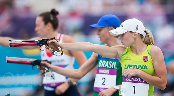 12 AUG 2012 - LONDON, GBR - Laura Asadauskaite (LTU) of Lithuania takes her third set of shots during the women's London 2012 Olympic Games Modern Pentathlon Combined Event in Greenwich Park, Greenwich, London, Great Britain .(PHOTO (C) 2012 NIGEL FARROW) (NIGEL FARROW/(C) 2012 NIGEL FARROW)