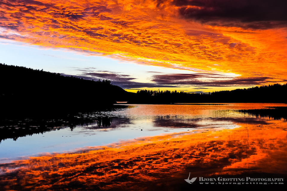 Sweden, Värmland, Sunset. Fire in the sky. Colourful sunset at a small lake in Värmland, not far from the Norwegian border. (Photo Bjorn Grotting)
