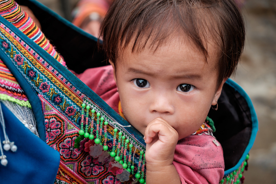 BAC HA, VIETNAM - CIRCA SEPTEMBER 2014:  Vietnamese baby girl at the Bac Ha sunday market, the biggest minority people market in Northern Vietnam (Daniel Korzeniewski)