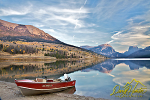 Fishing boat, fall colors, Green River Lake, Wind River Mountains, Pinedale, Wyoming (and his 35mms and headed to Jackson Hole Wyoming. Besides selling photography Daryl also publishes the Greater Yellowstone Resource Guide www.greater-yellowstone.com.)