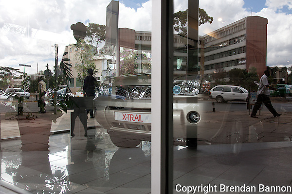 The showroom window at DT Dobie in Nairobi, Kenya. (Photographer: Brendan Bannon)