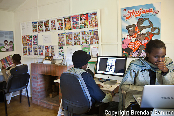 Staff and artists at the offices of Shujaaz FM creating the next issue of the comic. (Brendan Bannon)