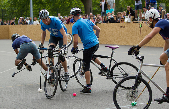 17 AUG 2014 - LONDON, GBR - A player from Sentinels (in light blue) tries to find a way to the Jackie Chan is Dead goal at the 2014 London Open Bike Polo tournament in Highbury Fields in London, Great Britain (PHOTO COPYRIGHT © 2014 NIGEL FARROW, ALL RIGHTS RESERVED) (NIGEL FARROW/COPYRIGHT © 2014 NIGEL FARROW : www.nigelfarrow.com)