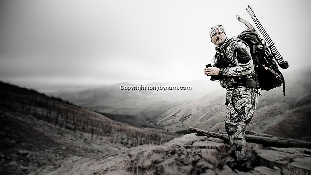 outdoor photography, bowhunter hunting elk deer mountains of montana burn area, fall hunting, bow hunting bow hunter in the field hunting old burn in western mountains (tony bynum)
