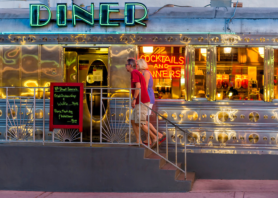 Miami Beach - Circa 2012: Couple walking into a retro diner in Miami Beach. Editorial Usage Only. (Daniel Korzeniewski)