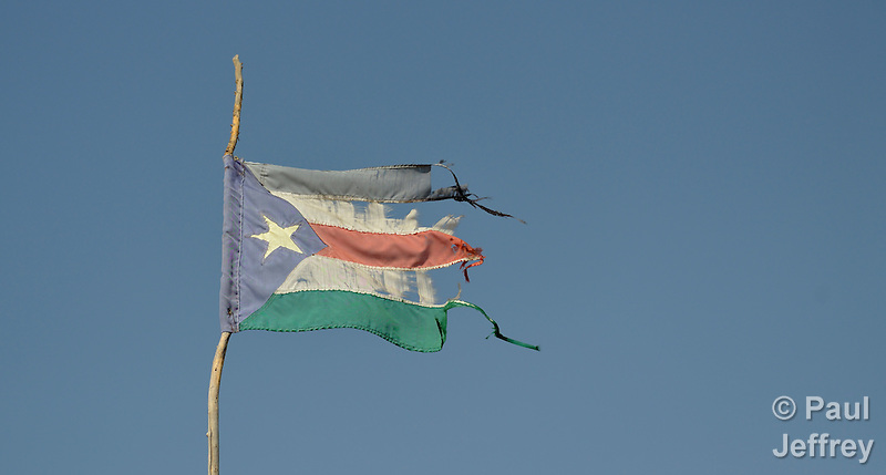 The flag of South Sudan, a little worse for wear, flies over the market in the town of Alek. (Paul Jeffrey)
