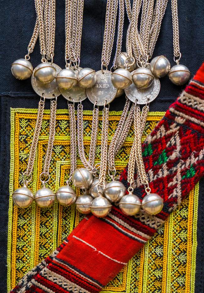 SAPA, VIETNAM - CIRCA SEPTEMBER 2014:  Detail of brocade and silvers from the Red Dao ethnic minority in the Village Ta Phin near Sapa, North Vietnam. (Daniel Korzeniewski)