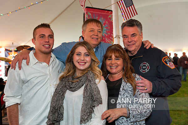 Fund raiser for firefighter Ray Pfeifer on Saturday, March 31, 2012, at East Meadow Firefighters Benevolent Hall, New York, USA. Rep. Pete King shown with Ray Pfeifer and the firefighter's wife CARYN, daughter TAYLOR, and son TERRENCE. (Ann Parry/Ann-Parry.com)