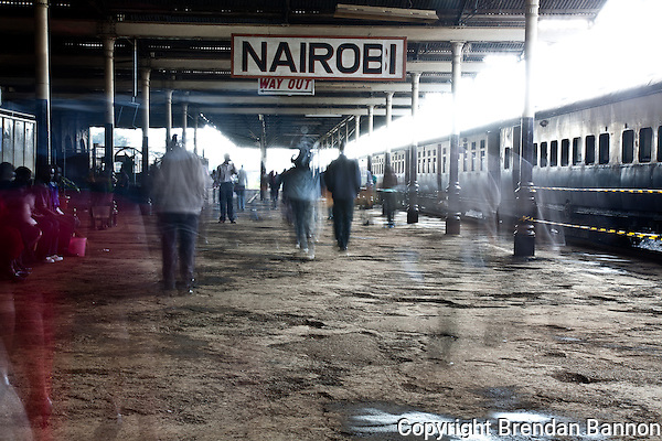 The ghosted figures of fast moving commuters in Nairobi Railways Station. (Brendan Bannon)