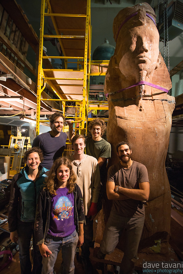 The team of artists from top left pose with Colossus: Joel Erland, Alex Miller, Kate Kaman, James Sullivan, Miguel Antonio Horn, and Cory Kram. (Dave Tavani)