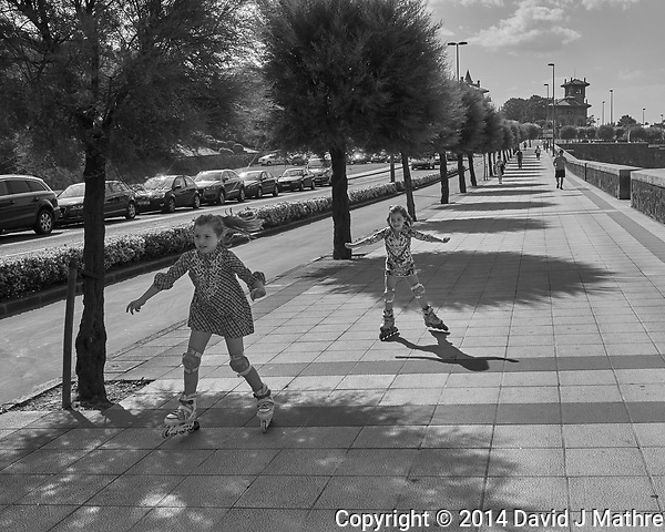 Sidewalk Skaters in Getxo Spain. Image taken with a Leica X2 camera (ISO 100, 24 mm, f/6.3, 1/2000 sec). Raw image processed with Capture One Pro, and Photoshop CC 2014 (David J Mathre)