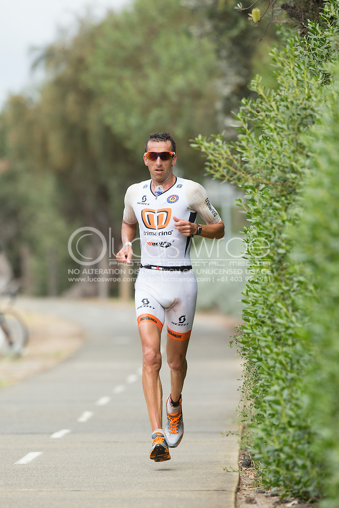 Marino VANHOENACKER (BEL) On The Run Course. Ironman Asia Pacific Championship Melbourne. Triathlon. Frankston And St Kilda, Melbourne, Victoria, Australia. 24/03/2013. Photo By Lucas Wroe (Lucas Wroe)