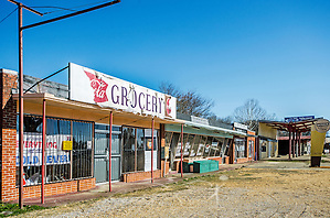 An abandoned strip mall sits beside Civil Rights Memorial Park, Feb. 7, 2015, in Selma, Alabama. The park was established in 2001 and includes murals and plaques honoring those who led the Civil Rights movement in Selma in the 1960's. (Photo by Carmen K. Sisson/Cloudybright) (Carmen K. Sisson/Cloudybright)