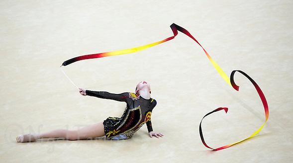 11 AUG 2012 - LONDON, GBR - Alina Maksymenko (UKR) of Ukraine performs her ribbon routine during the 2012 London Olympic Games Individual All-Around Rhythmic Gymnastics final at Wembley Arena in London, Great Britain (PHOTO (C) 2012 NIGEL FARROW) (NIGEL FARROW/(C) 2012 NIGEL FARROW)