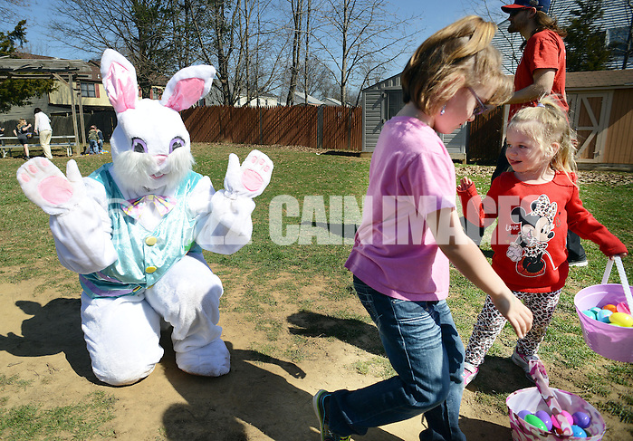 FAIRLESS HILLS, PA - APRIL 12:  The Easter Bunny, portrayed by Diana Nordtveit waves goodbye to Lily Nahill (C), 7 and Alaina Sottile, 4 of Morrisville, Pennsylvania during the YMCA Easter Egg Hunt April 12, 2014 in Fairless Hills Pennsylvania. (Photo by William Thomas Cain/Cain Images) (William Thomas Cain)