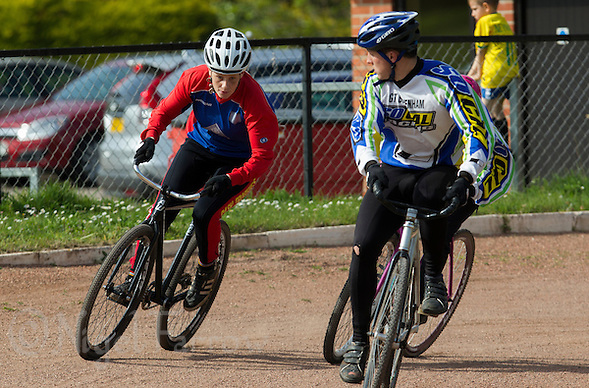10 MAY 2015 - GREAT BLAKENHAM, GBR - Lauren Jacobs (left) of Ipswich Eagles Cycle Speedway Club tries to find a way past Jon Jo Slaughter of Great Blakenham during their South East 2 League fixture at Great Blakenham, Suffolk, Great Britain (PHOTO COPYRIGHT © 2015 NIGEL FARROW, ALL RIGHTS RESERVED) (NIGEL FARROW/COPYRIGHT © 2015 NIGEL FARROW : www.nigelfarrow.com)