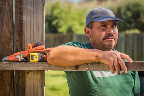 Landscaper Adan Reyes takes a break from a  small landscaping project on School Street in Calistoga. (Clark James Mishler)