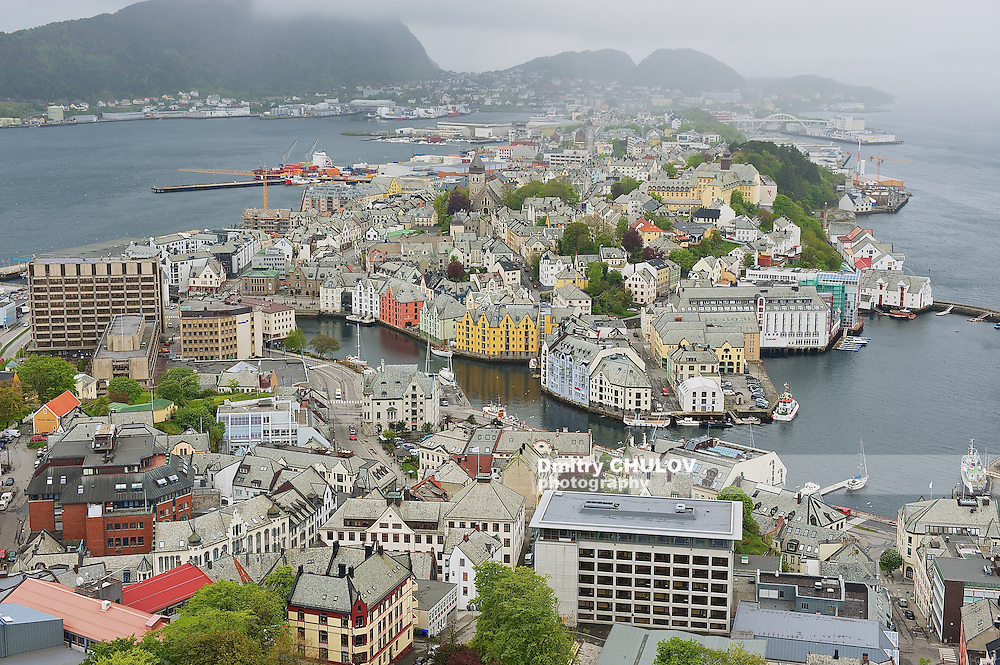 ALESUND, NORWAY - JUNE 03, 2010: View to the Alesund city on a cloudy summer day in Alesund, Norway. (Dmitry Chulov)