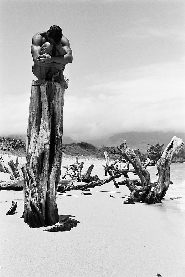 "�Every artist stands on the shoulders of those who came before to see a little further.� When I was waking down a beach on Maui with Carl, we saw this tree trunk. I told Carl, �Mapplethorpe put black men on pedestals after George Dureau made photos of men on pedestals who were midgets or amputees. The pedestal is, of course, a classical idea. I asked Carl to climb the tree. �We�re going to make the Bianchi version of the Mapplethorpe version of the Dureau version of the pedestaled nude.� Photo published in OUT OF THE STUDIO Limited Editions 8 x 10""    6 of 100 11 x 14""  4 of 25 16 x 20""  4 of 25 18 x 24""  3 of 10 24 x 30""  3 of 10 30 x 40""  2 of 5 40 x 55""  2 of 5 (Tom Bianchi)"