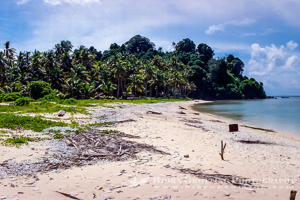 Riau Islands, Natuna Islands. Beach, fishermen have some small huts under the trees where they can stay during the night.  Southwest Natuna. small island just north of Kalimantan. (Bjorn Grotting)