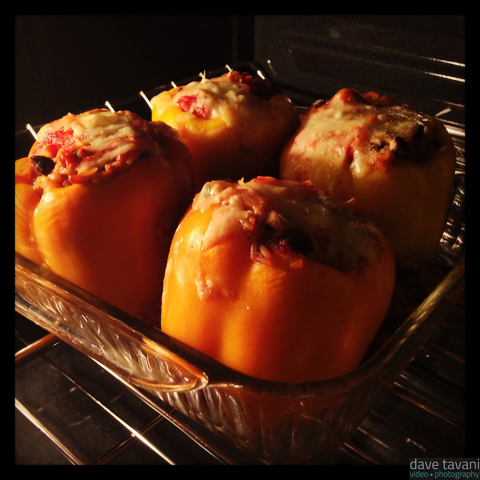 Vegetarian stuffed peppers cook in the oven on January 21, 2013. (Dave Tavani)