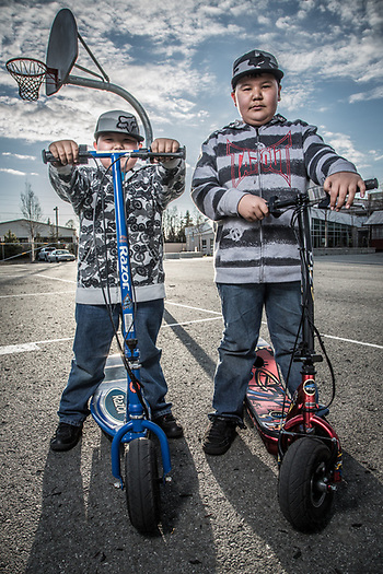 Brothers Brendon and Corey Ransdell  with their electric skooters at Chugach Elementary School, Anchorage (Clark James Mishler)