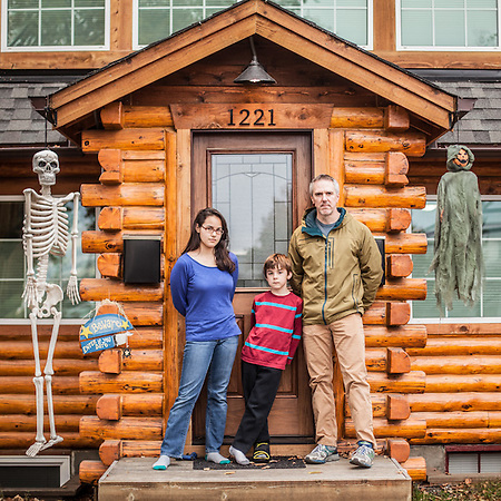 "Brian Duryea with children Alma (13) and son Andy (8) in front of their home on 10th Avenue in Anchorage's South Addition neighborhood.  ""I have restored this house almost single handedly.""  bw_duryea@yahoo.com (© Clark James Mishler)"