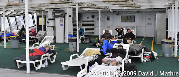 Passengers on the Alaska Marine Highway MV Columbia camping on the Solarium deck. Composite of two images taken with a Nikon D3 camera and 50 mm f/1.4 lens (ISO 1600, 50 mm, f/4, 1/250 sec). (David J Mathre)