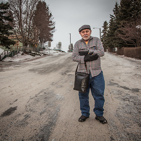 "Architect Ivan Becerra in Anchorage's South Addition neighborhood.  ""Where did you get your glasses?""  ""I just broke mine and I have been looking for new frames exactly like your's!"" (© Clark James Mishler)"