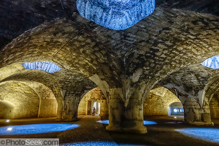In Munot Castle's lower chamber, explore a spectacular, cool vaulted casemate built in the Renaissance, in Schaffhausen, Switzerland, Europe. The Munot, Schaffhausen's iconic circular fortress, was built by forced labor in 1564-1589 after the religious wars of the Reformation. (© Tom Dempsey / PhotoSeek.com)