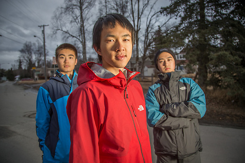 "Chinese college freshmen students Diwei Xiong, Shang Shangwen Su and Lucas Lu from southern Califonia explore Bootleggers Cove in Anchorage.  ""We decided to come to Alaska for spring break..we like to camp and hike."" (© Clark James Mishler)"