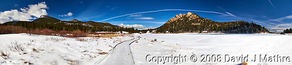 Winter trail and panorama at Lily Lake in Rocky Mountain National Park. Composite of five images taken with a Nikon D3 camera and 24-70 mm f/2.8 lens (ISO 200, 24 mm, f/16, 1/160 sec). Raw images processed with Capture One Pro and the composite generated using AutoPano Giga Pro. The jags in the contrails unfortunately show that the upper winds were strong while taking the five images. (David J Mathre)
