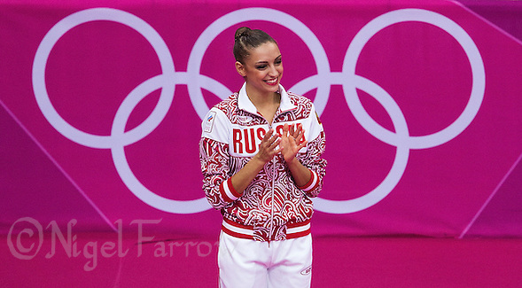 11 AUG 2012 - LONDON, GBR - Evgeniya Kanaeva (RUS) of Russia waits to be presented with her gold medal after winning the London 2012 Olympic Games Individual All Around Rhythmic Gymnastics final at Wembley Arena, London, Great Britain .(PHOTO (C) 2012 NIGEL FARROW) (NIGEL FARROW/(C) 2012 NIGEL FARROW)
