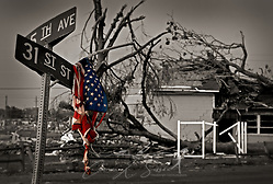 A shredded flag hangs on a street sign in Tuscaloosa following the F-4 tornado that ripped through the town on April 27, 2011, killing 44 people. (Photo by Carmen K. Sisson/Cloudybright) (Carmen K. Sisson/Cloudybright)