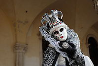 Woman dressed in traditional mask and costume for Venice Carnival standing at Doge's Palace, Piazza San Marco, Venice, Veneto, Italy (Brad Mitchell Photography)