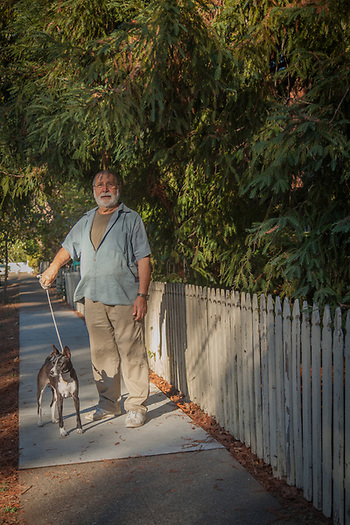 Gallery owner Carlo Marchiori on a walk around the block with his dog, Togo, Calistoga (© Clark James Mishler)