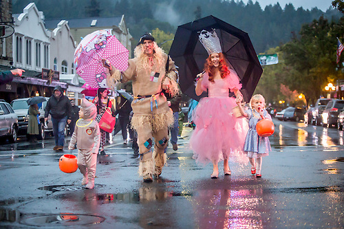 Derek, Christina and their kids bring the energy of the Wizard of OZ on a wet Halloween Parade in Calistoga. (Clark James Mishler)