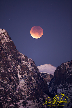 Moon eclipse over Death Canyon in Grand Teton National Park.