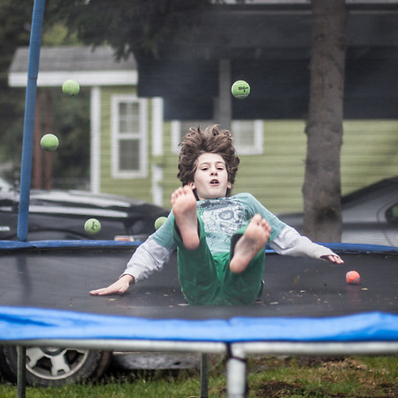 Boys on their trampoline in their front yard north of Fireweed Blvd. on Arctic Blvd., Anchorage (© Clark James Mishler)