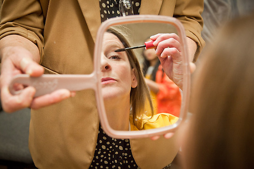 "A young woman applies makeup in preparation of her walk down the run-way for the fashion show during the ""Success Inside & Out"" event at Highland Correctional Facility, Eagle River, Alaska (Clark James Mishler)"