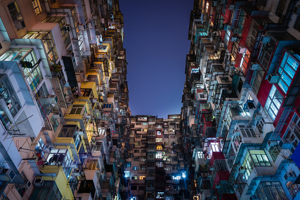 Exterior of old Hong Kong apartment building at night (Mark Eden)