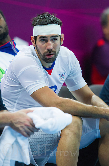 08 AUG 2012 - LONDON, GBR - Nikola Karabatic (FRA) of France recovers on the bench after needing treatment for a head injury during the men's London 2012 Olympic Games quarter final match against Spain at the Basketball Arena in the Olympic Park, in Stratford, London, Great Britain (PHOTO (C) 2012 NIGEL FARROW) (NIGEL FARROW/(C) 2012 NIGEL FARROW)
