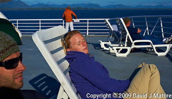 Jonathan and Christine Sleeping in the Afternoon Sun. Solarium Deck on the M/V Columbia Alaska Marine Highway Between Bellingham, Washington and Haines, Alaska. Image taken with a Nikon D3 and 50mm f/1.4 lens (ISO 200, 50 mm, f/11, 1/500 sec). (David J Mathre)
