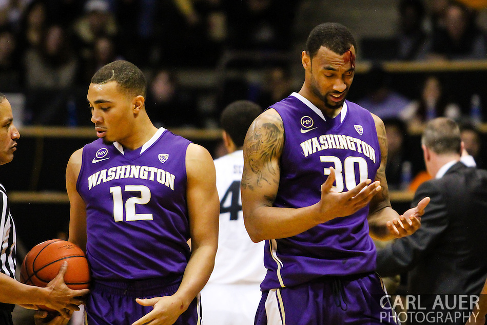 February 9th, 2014:  Washington Huskies junior forward Desmond Simmons (30) heads to the bench after a elbow drew blood from his forehead in the first half of action in the NCAA Basketball game between the Washington Huskies and the University of Colorado Buffaloes at the Coors Events Center in Boulder, Colorado (Carl Auer/ZUMAPRESS.com)