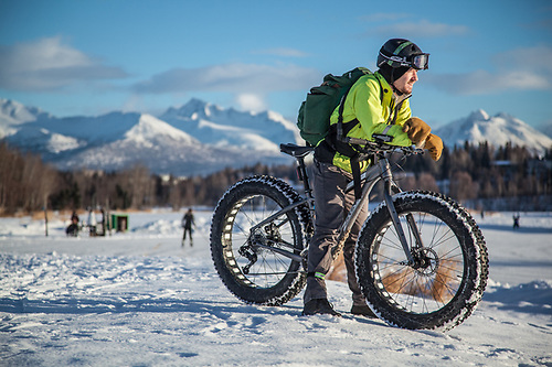 "Raven Alaska pilot and Ohio transplant John Myers on his fat tire bike on a beautiful afternoon overlooking Westchester Lagoon, Anchorage.  ""I've always wanted one of these and after I moved to Anchorage, I finally bought one.""  ""I love it here…so much better than Ohio!""  myers.nodak@gmail.com (© Clark James Mishler)"