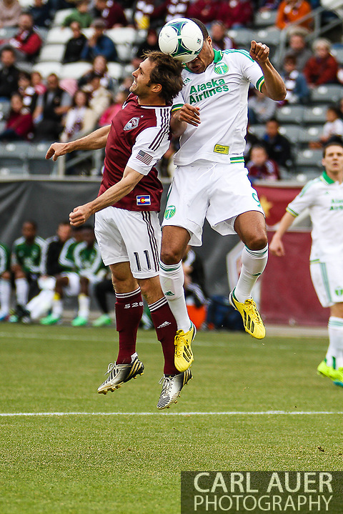 March 30th, 2013 Commerce City, CO - Colorado Rapids midfielder Brian Mullan (11) and Portland Timbers forward Ryan Johnson (9) both attempt to head the ball in the first half of the MLS match between the Portland Timbers and the Colorado Rapids at Dick's Sporting Goods Park in Commerce City, CO (Carl Auer/Newsport)